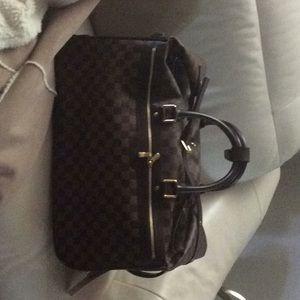 Louis Vuitton Eole 50 travel roller blade